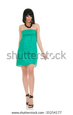 Beautiful fashion model in green mini dress isolated over white background - stock photo
