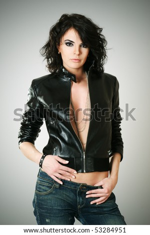 Beautiful fashion model posing in studio - stock photo