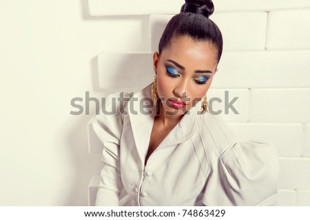 Beautiful fashion model wearing a fashionable white leather jacket - stock photo