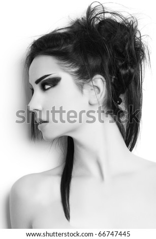 beautiful fashion model with long hair and loop of hair black and white - stock photo