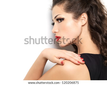 Beautiful fashion model with red manicure and lips - isolated on white background - stock photo