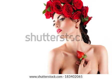 beautiful fashion model with red roses hairstyle and strawberry