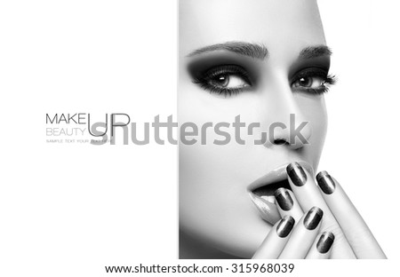 Beautiful fashion model woman with black nail art and smoky eyes. Beauty and Makeup concept Perfect skin. Close up monochrome portrait isolated on white. Template design with sample text - stock photo
