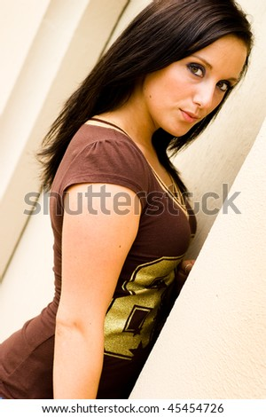 Beautiful fashion model woman with brown hair in her football shirt