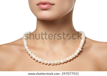 Beautiful fashion pearls necklace on the neck. Jewellery and bijouterie  - stock photo