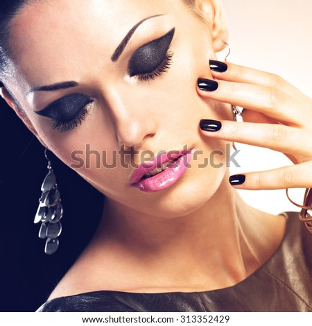 Beautiful fashion sexy woman with black nails at pretty face. Pretty girl  - stock photo