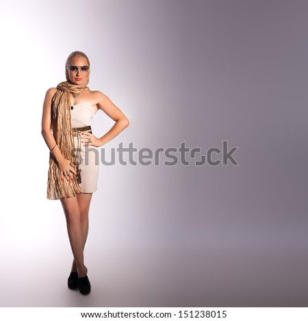 beautiful fashion woman in sunglasses over grey background
