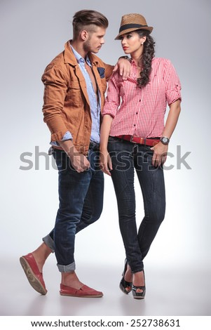 Beautiful fashion woman looking at the boyfriend while he is leaning on her. - stock photo