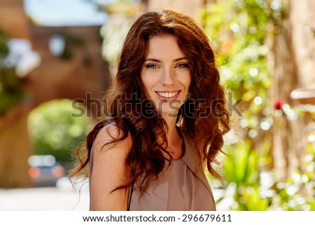 Beautiful fashion woman outdoor on the street of the old town - stock photo