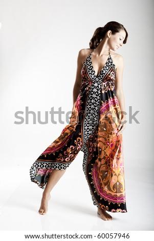 Beautiful fashion woman posing with a colorful dress - stock photo