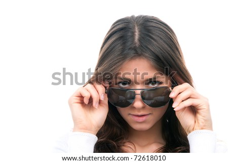 Beautiful fashion woman wearing off sunglasses isolated on a white background - stock photo