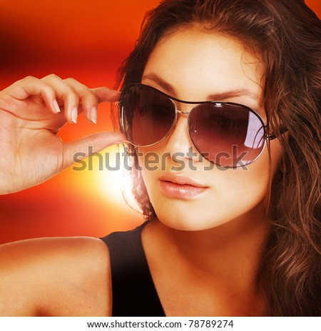 Beautiful fashion woman wearing sunglasses - stock photo