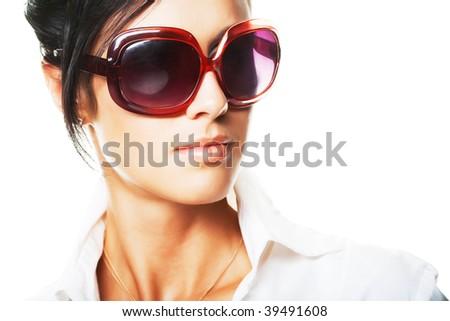 beautiful fashion woman wearing sunglasses over a white background - stock photo