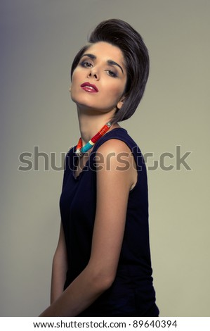 Beautiful fashion woman with straight short hairstyle posing - stock photo