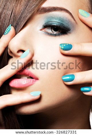 Beautiful  fashion woman with turquoise make-up and nails - stock photo