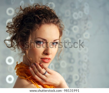 Beautiful Fashion Young Woman in Paper dress.Perfect Makeup. Orange thread lace. Light Grey background with copy-space