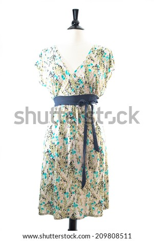 Beautiful, fashionable hand made dress, on mannequin, isolated on white background in studio - stock photo