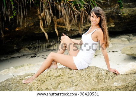Beautiful fashionable model on the beach in white - stock photo