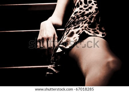 beautiful fashionable woman at the stairs - stock photo