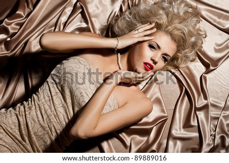 beautiful fashionable woman in beige clothes - stock photo