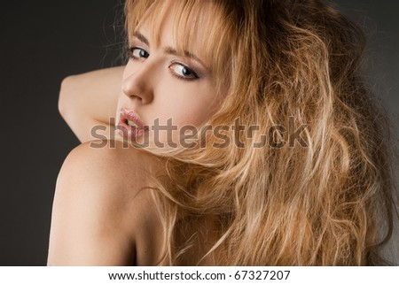 beautiful fashionable woman in black background - stock photo