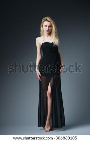 beautiful fashionable woman in black dress studio shot - stock photo