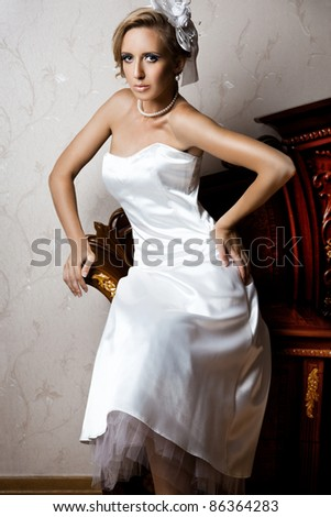 beautiful fashionable woman in interior - stock photo