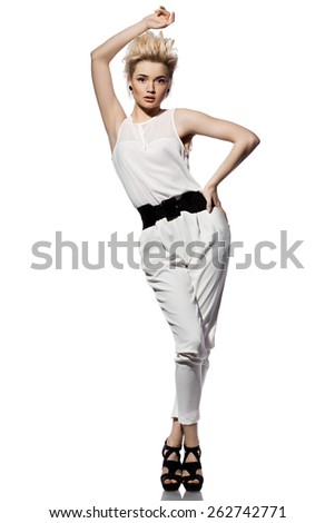 beautiful fashionable woman in white suit - stock photo
