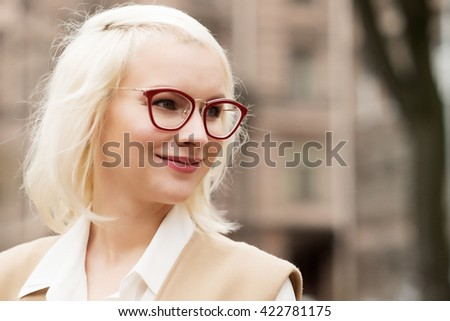 Beautiful fashionable woman on the city street.