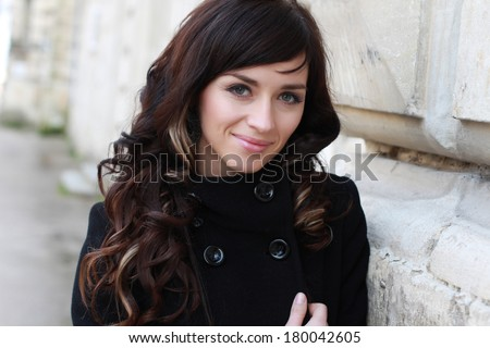 Beautiful fashionable woman standing on the city street. Fashion Look - stock photo