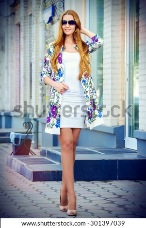 Beautiful fashionable woman walking on the city street. Elegant businesswoman outdoor.  - stock photo