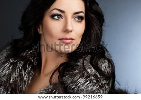 beautiful fashionable woman with fur - stock photo