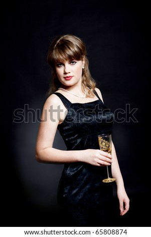 beautiful fashionable woman with glass of wine