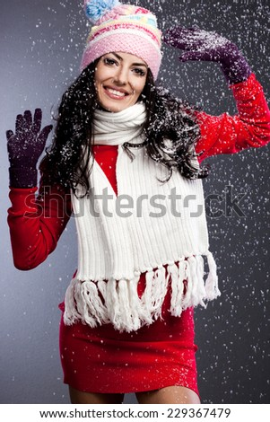 beautiful fashionable woman with snow - stock photo