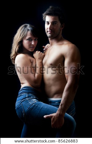 Beautiful fashionable young couple dressed in jeans