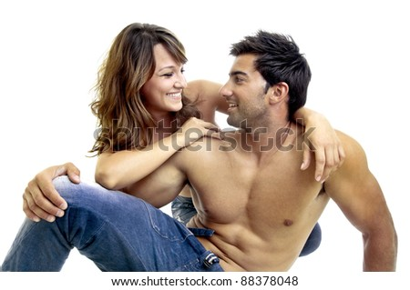 Beautiful fashionable young couple dressed in jeans - stock photo