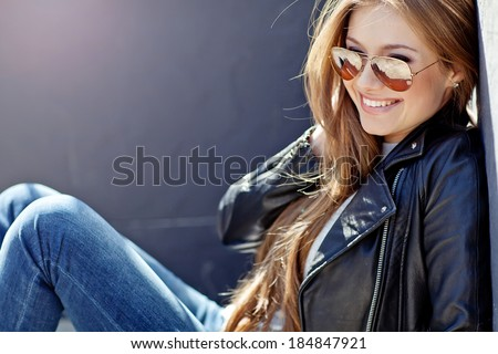Beautiful fashionable young woman - stock photo