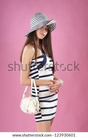 Beautiful fashionable young woman posing in studio - stock photo