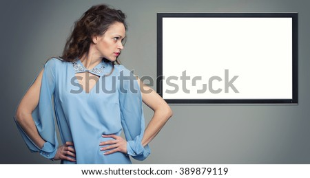 beautiful fassion woman and TV hanging on the wall. Copy space