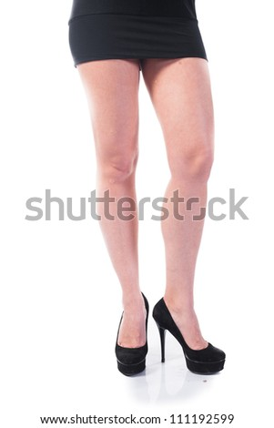 Beautiful feet in shoes isolated over white background