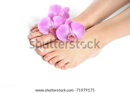 Beautiful feet with perfect spa french nail pedicure.isolated - stock photo
