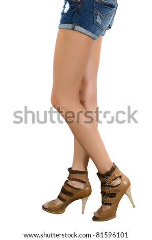 beautiful femail legs in shoes isolated on white - stock photo