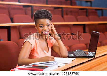 beautiful female african college student in lecture room - stock photo