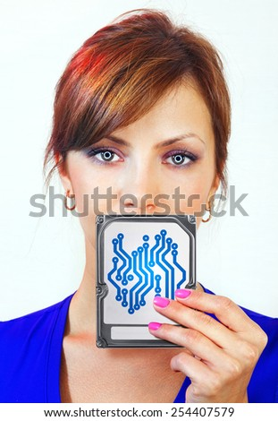 beautiful female android holds digital device on her hand - stock photo