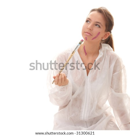 Beautiful female artist with a violet brush - isolated over white - stock photo