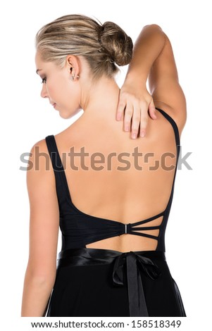 Beautiful female ballet dancer isolated on a white background. Ballerina is wearing a black leotard and rubbing her injured neck. - stock photo