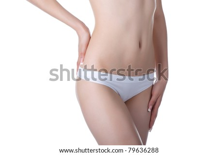 Beautiful female body isolated on white background. Sexy young woman in white panties. beauty concept - stock photo