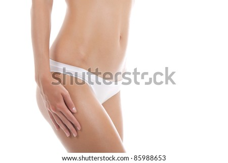 Beautiful female body isolated on white background. Sexy young woman in white panties checking cellulite on her legs hip. series photo - stock photo