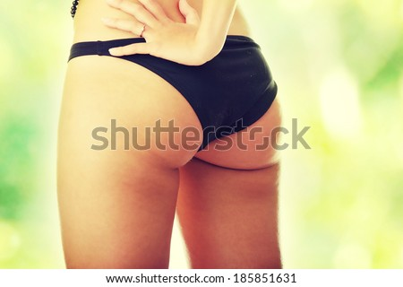 Beautiful female body isolated on white. Sexy young woman in black panties  - stock photo