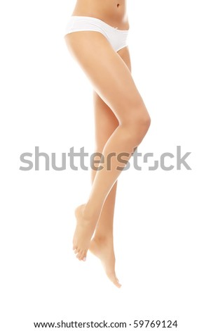 Beautiful female body isolated on white. Sexy young woman in white panties - stock photo